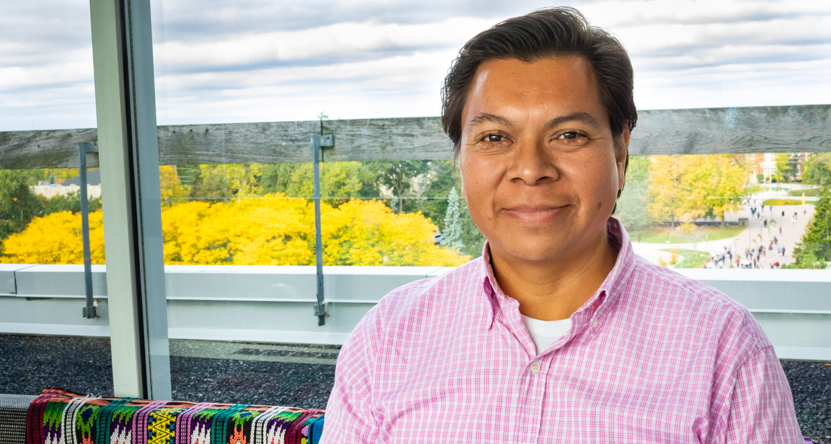 Portrait of graduate student Oscar Lopez Hernandez with the U of G campus in the background