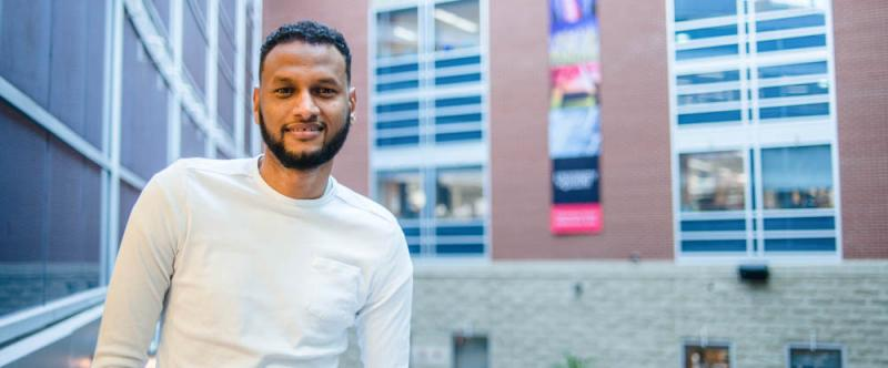 Portrait of U of G graduate student, Abdalla Albeely (PhD, Molecular & Cellular Biology with Neuroscience) in the Science Atrium at the University of Guelph