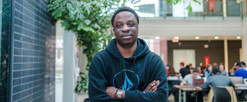 Portrait of graduate student Trust Katsande (MSc, Plant Agriculture) in the atrium of the Albert A. Thornbrough Building, University of Guelph