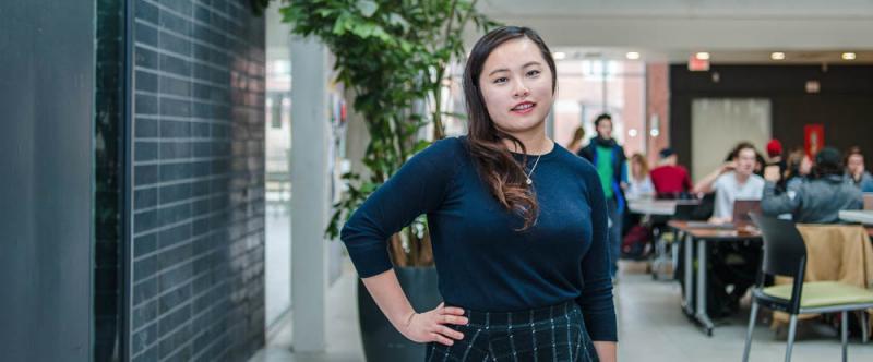 Portrait of graduate student Karen Pun (MSc, Food Safety & Quality Assurance) in the atrium of Albert A. Thornbrough Building, University of Guelph
