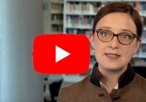Youtube logo over a screenshot of Professor Baes being interviewed