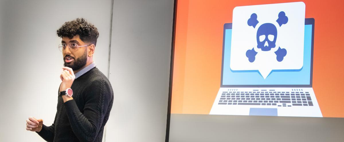 Faham Khan presenting his 3-Minute Thesis at U of G