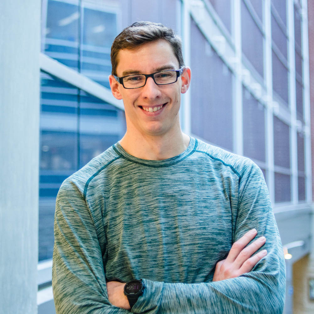Portrait of graduate student David Duhan (MSc, Planning) in the Albert A. Thornbrough Building, University of Guelph