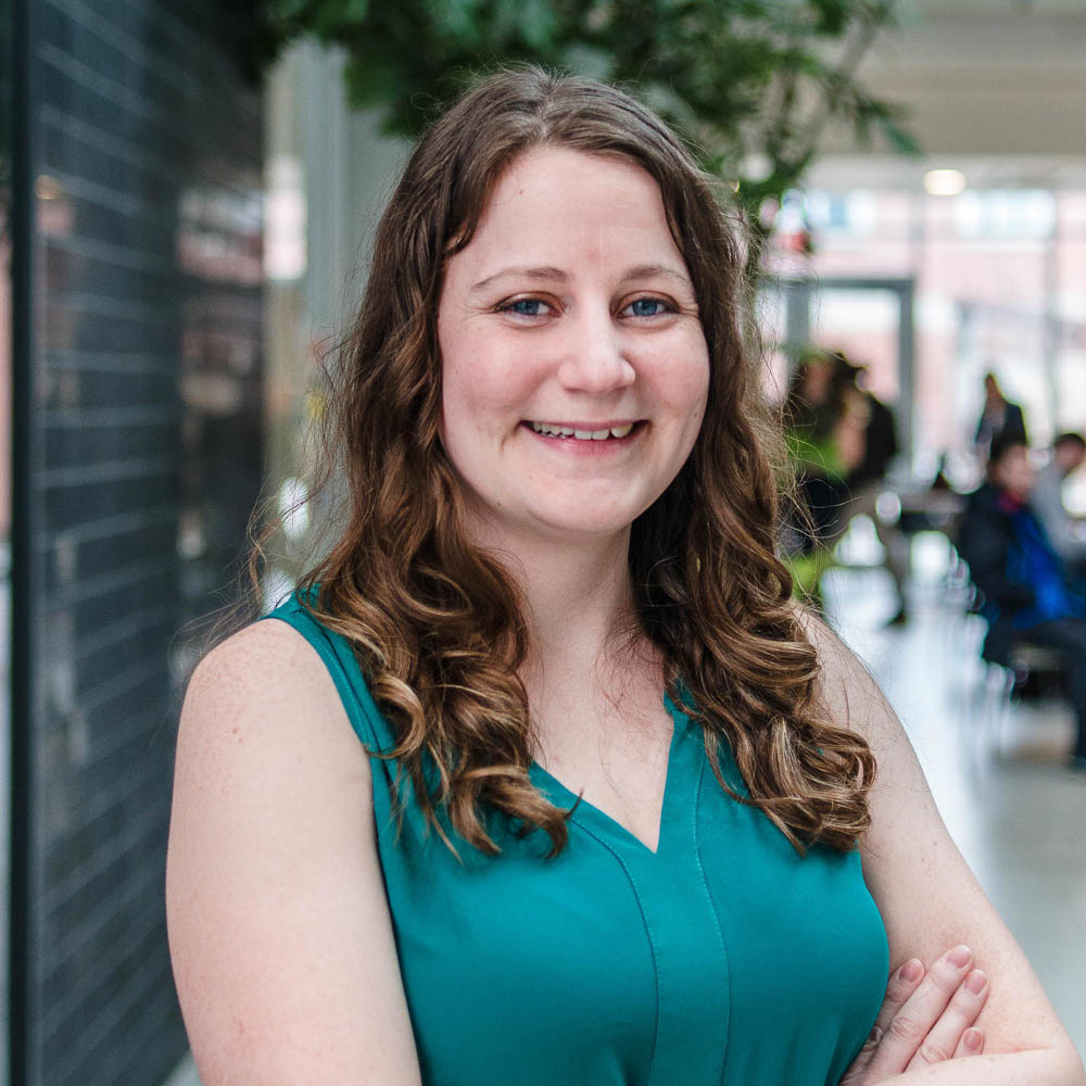 Portrait of graduate student Shannon French (PhD, Pathobiology) in the atrium of the Albert A. Thornbrough Building, University of Guelph
