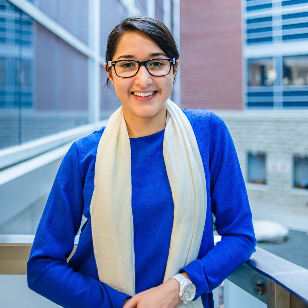 Portrait of graduate student Sidra Sarfaraz (MSc, Human Health & Nutrtional Sciences) in theScience Atrium at the University of Guelph