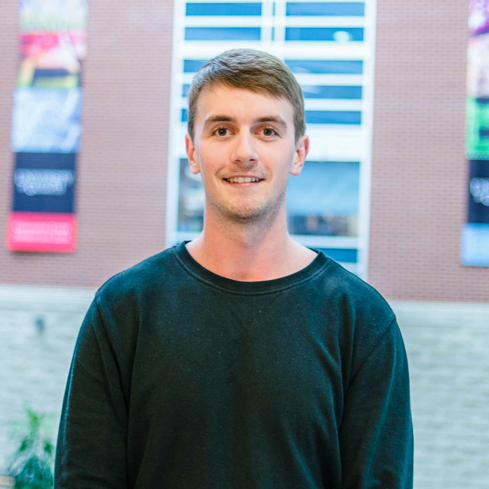 Profile of graduate student Matthew Rudland (MSc, Environmental Sciences) in the atrium of Mac Donald Stewart Hall at the University of Guelph