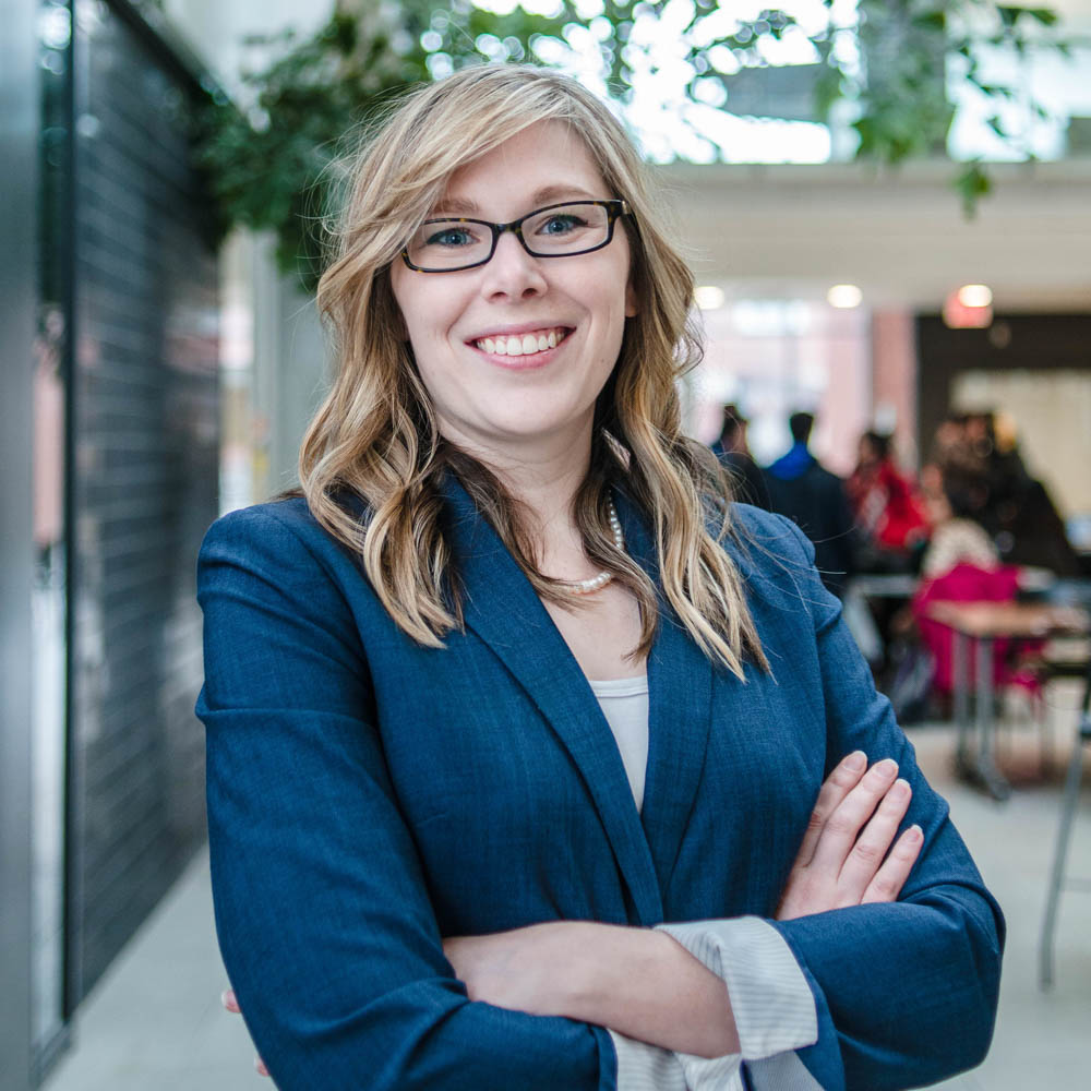 Portrait of graduate student Amberley Ruetz (PhD, Geography) in the Albert A. Thornbrough Building, University of Guelph
