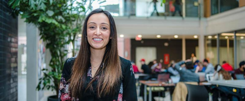 Portrait of graduate student Kiran Bains (MSc, Family Relations & Applied Nutrition) in the atrium of Albert A. Thornbrough Building, University of Guelph