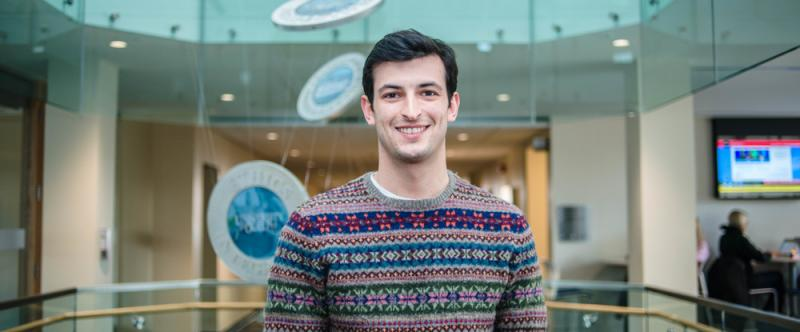 Portrait of graduate student Ethan Danielli (MSc, Human Health & Nutritional Sciences) in the atrium of Mac Donald Stewart Hall at the University of Guelph