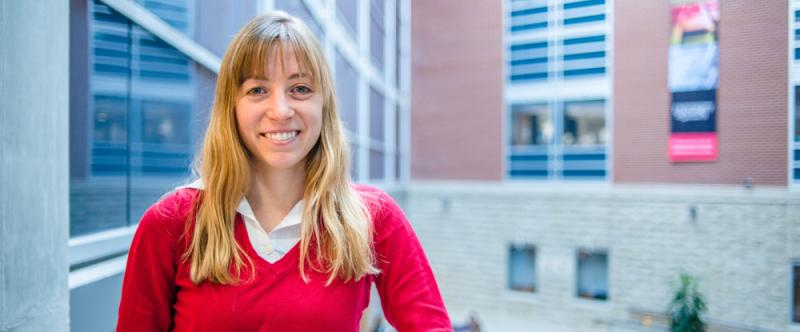 Portrait of graduate student Emma Plater (PhD, Human Health and Nutritional Sciences with Neuroscience) in the Science Atrium at the University of Guelph