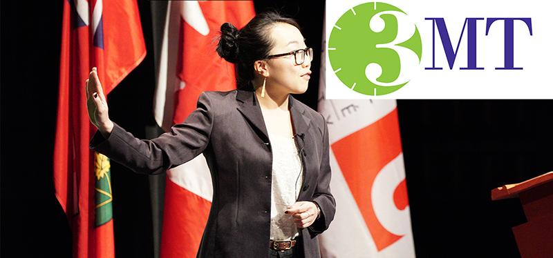 Candid of Jenny Liu on stage at the 3MT Finals with the 3MT logo